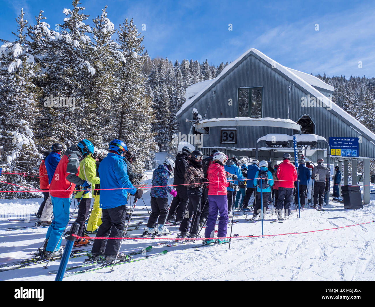 Lift line at Pete's Express Lift 39, winter, Blue Sky Basin, Vail Ski Resort, Vail, Colorado. - Stock Image