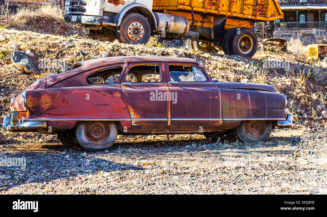 Vintage Four Door Rusted Automobile In Salvage Yard - Stock Image