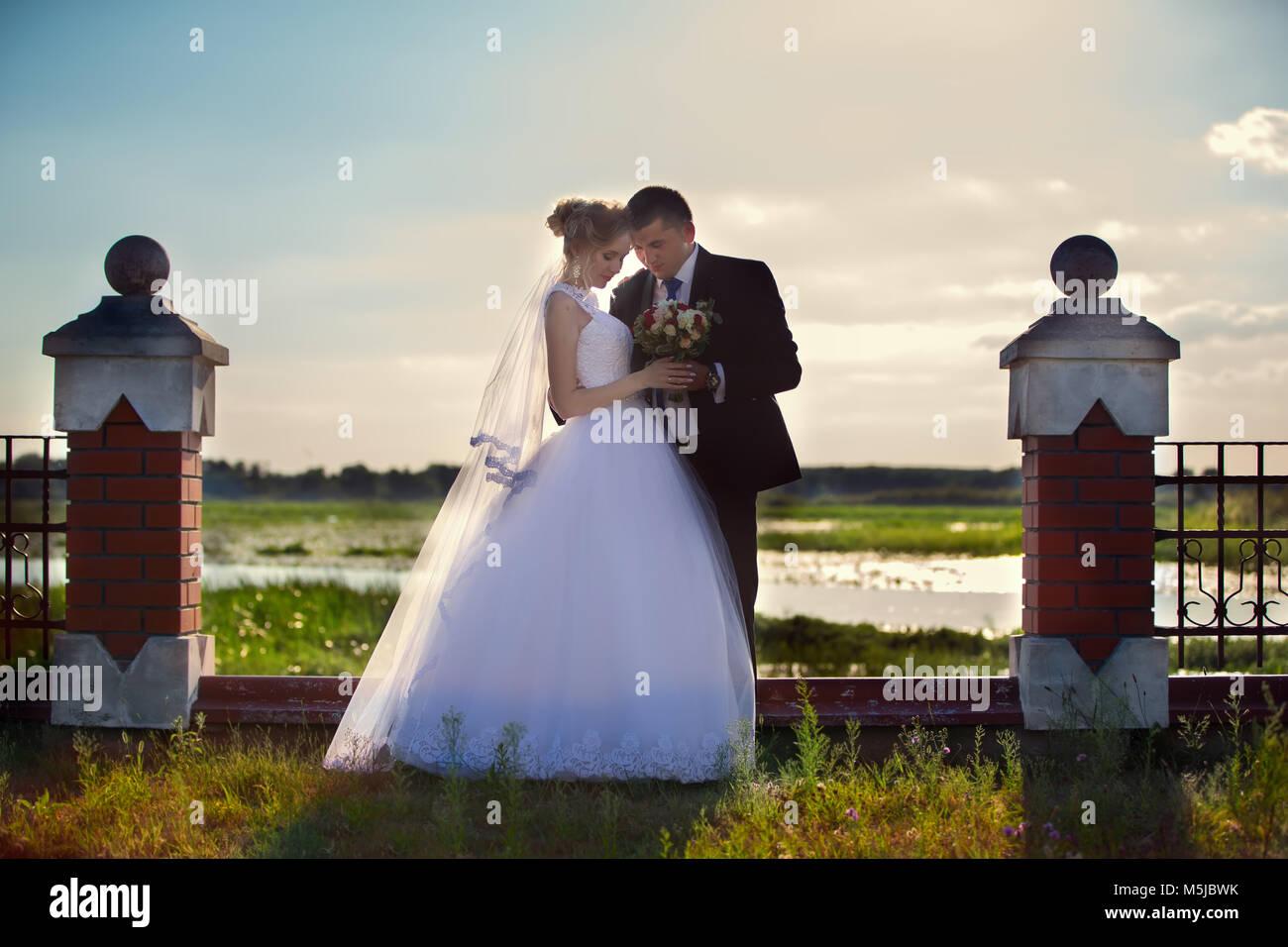 Belarus, Brest region, Motol village, August 05, 2017. Wedding park.Bride and groom on a wedding walk - Stock Image