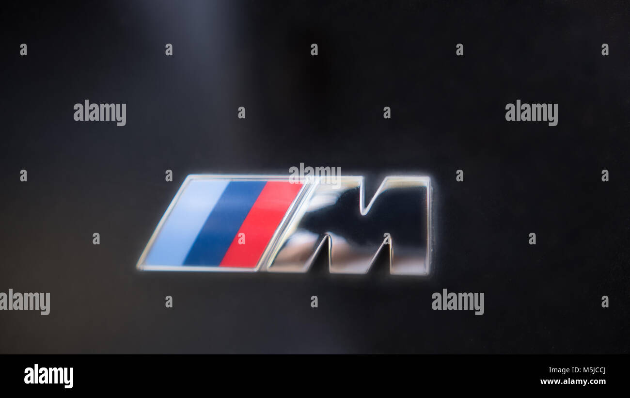 Kazan, Russia - july 2017 - logo sign for BMW M on black hood of the car - Stock Image