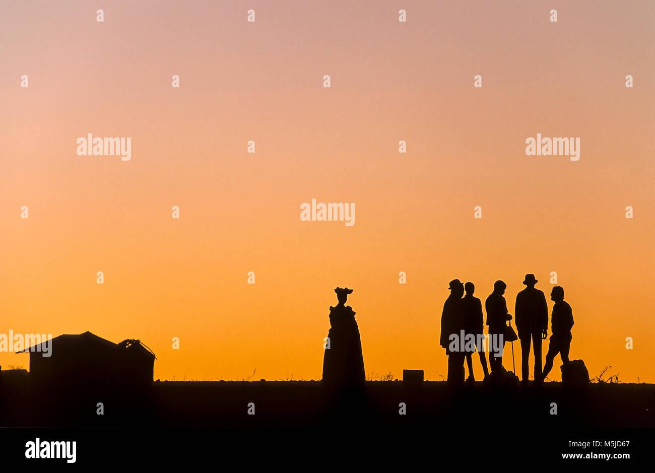 backlight at the sunset of herero people in Kaokoland, Namibia - Stock Image