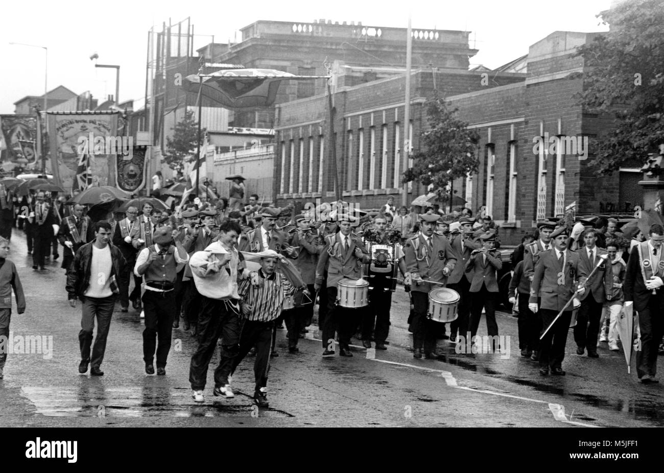 Black & white images showing the 12th of July in North Belfast, Northern Ireland. People in Northern Ireland - Stock Image