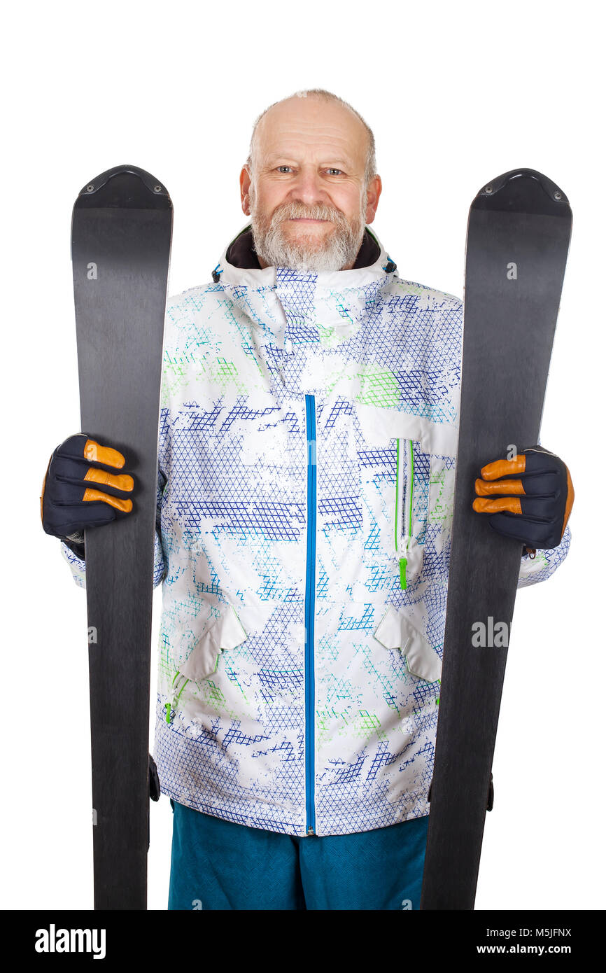 Handsome mature man in ski suit, holding skis on isolated background - Stock Image