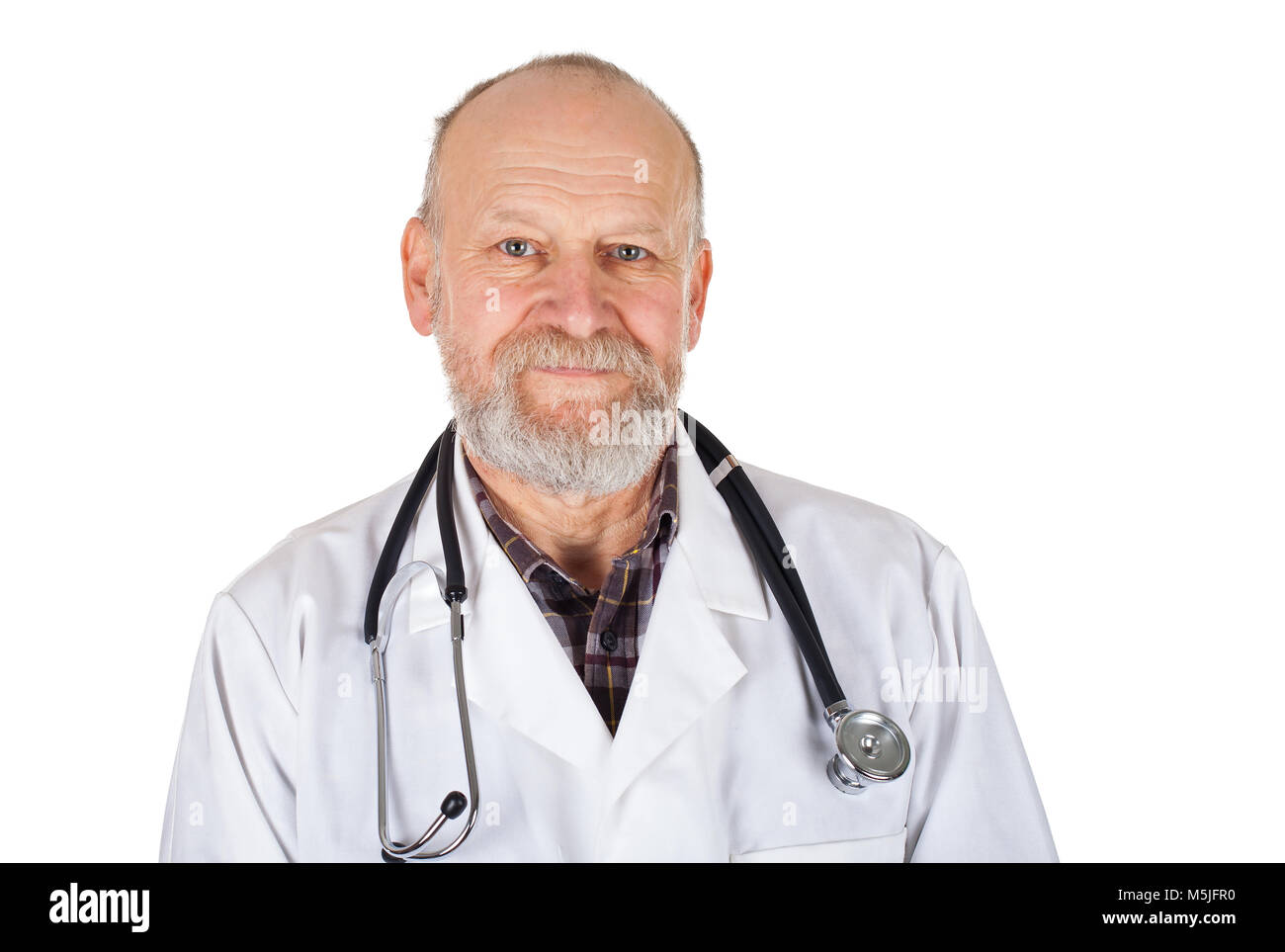 Portrait of mature medical doctor with white coat and stethoscope on isolated background - Stock Image