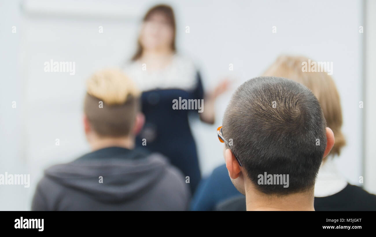 Caucasian speaker female teaching at international conference, business concept - Stock Image