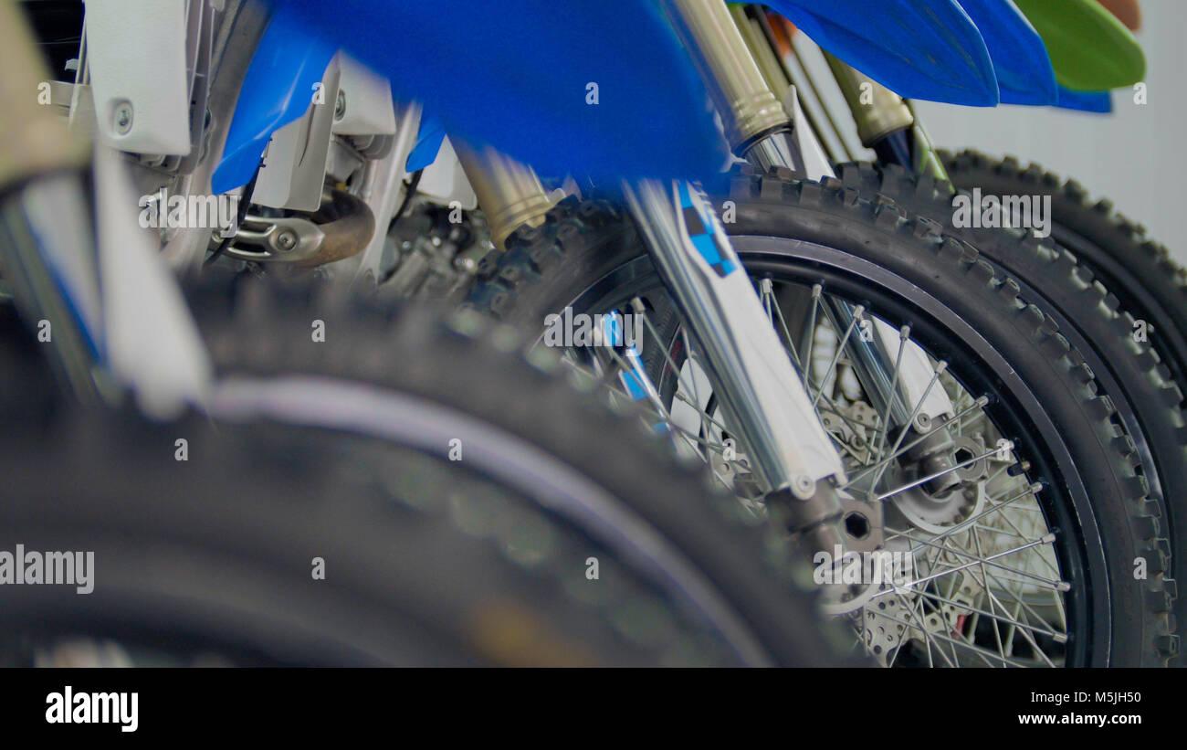 Wheels of motorcycle in the garage - enduro cross motorbike - Stock Image