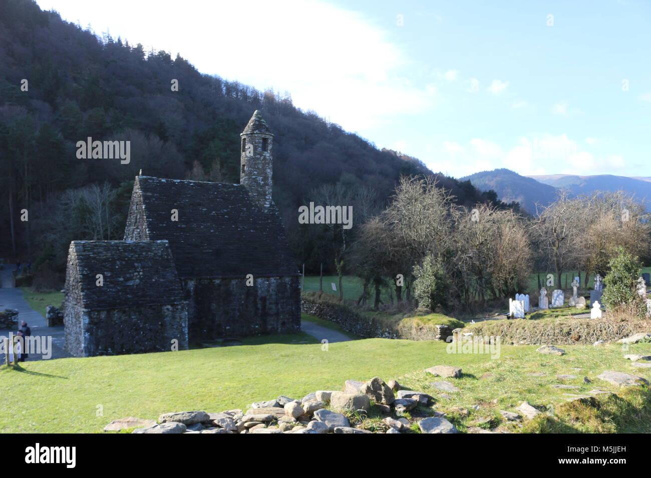 GLENDALOUGH, IRELAND - February 20 2018: The ancient cemetery in monastic site Glendalough. Glendalough Valley, - Stock Image