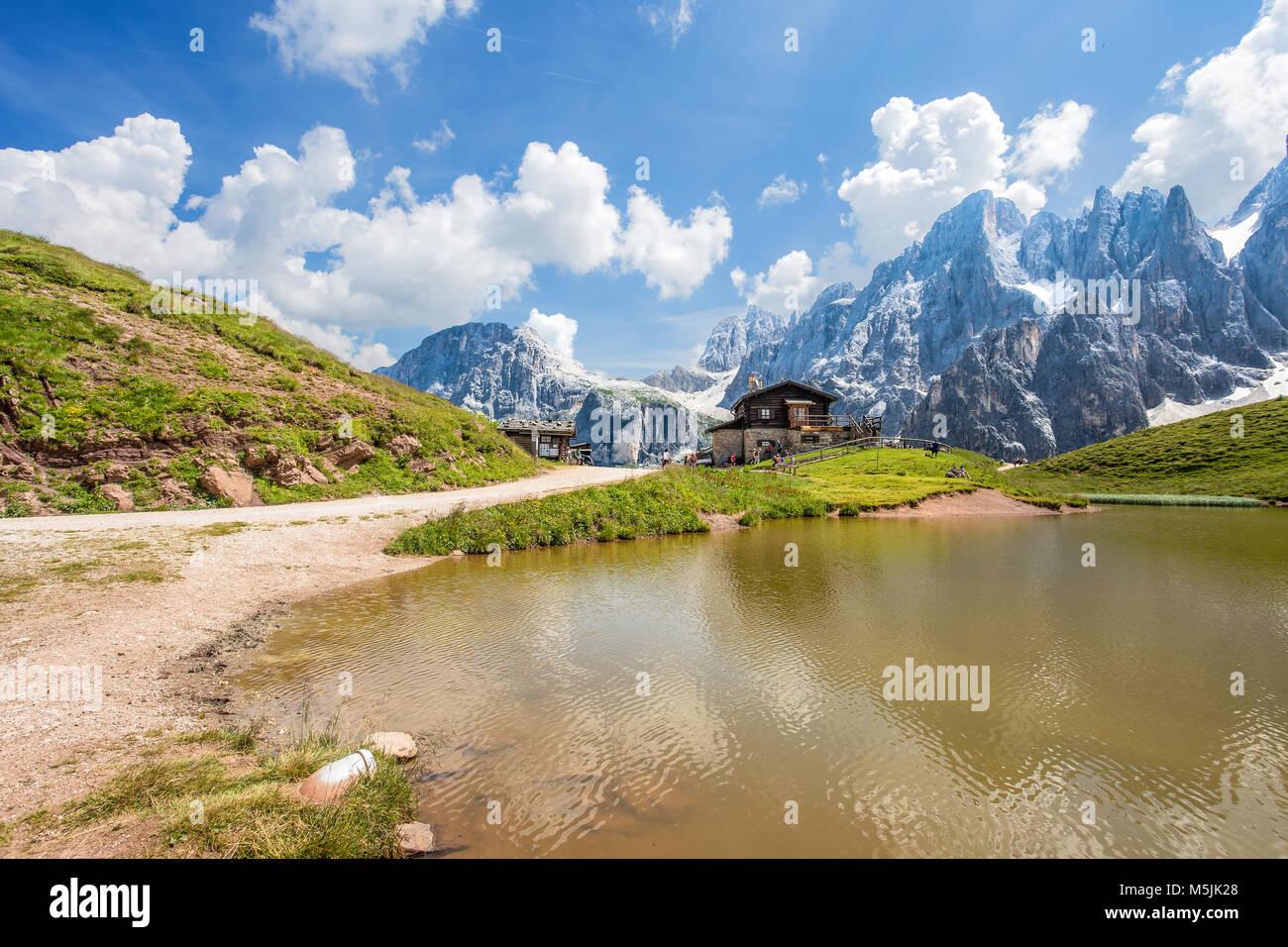 Dolomites Alps in Italy, Pale di San Martino mountains and Baita Segantini with the lake / landscape Stock Photo