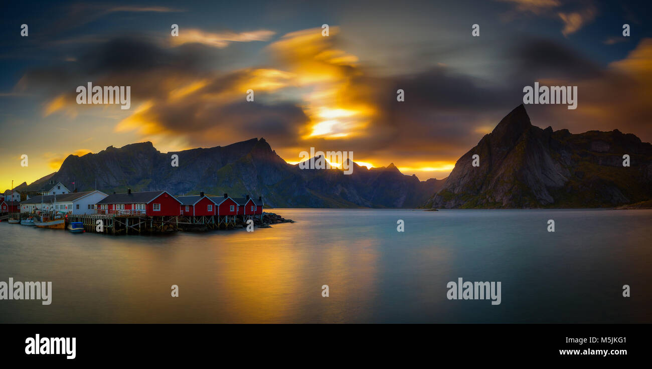 Sunset above mount Olstind and the village of Hamnoy in Norway - Stock Image