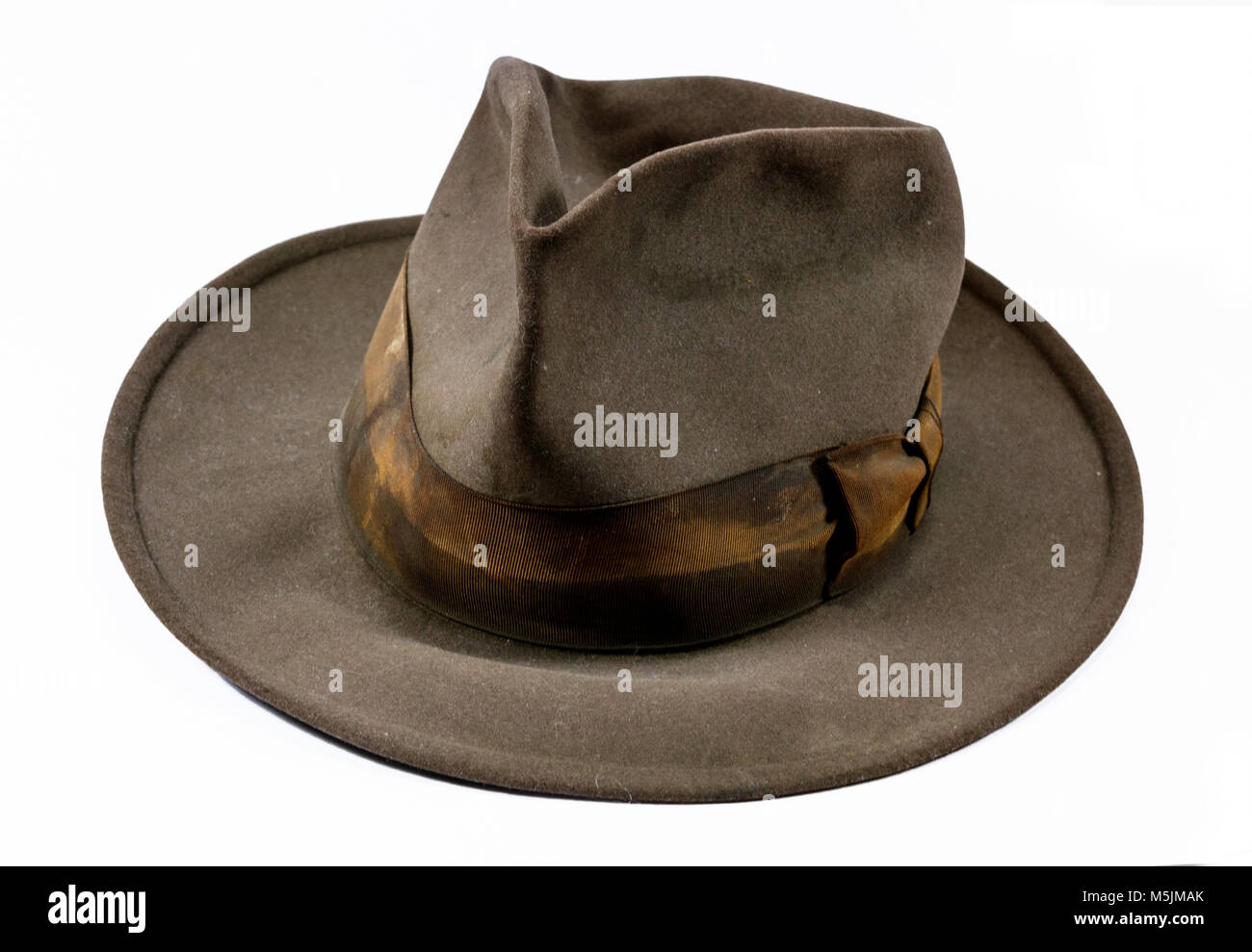 Antique vintage old worn out stained felt hat - Stock Image