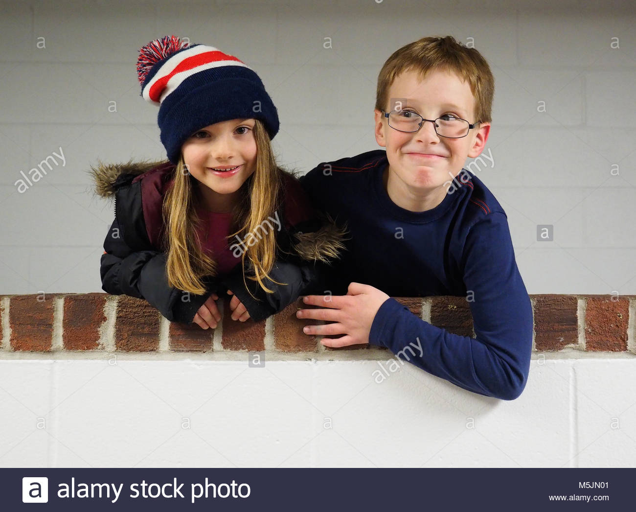 Young boy and girl making friends - Stock Image