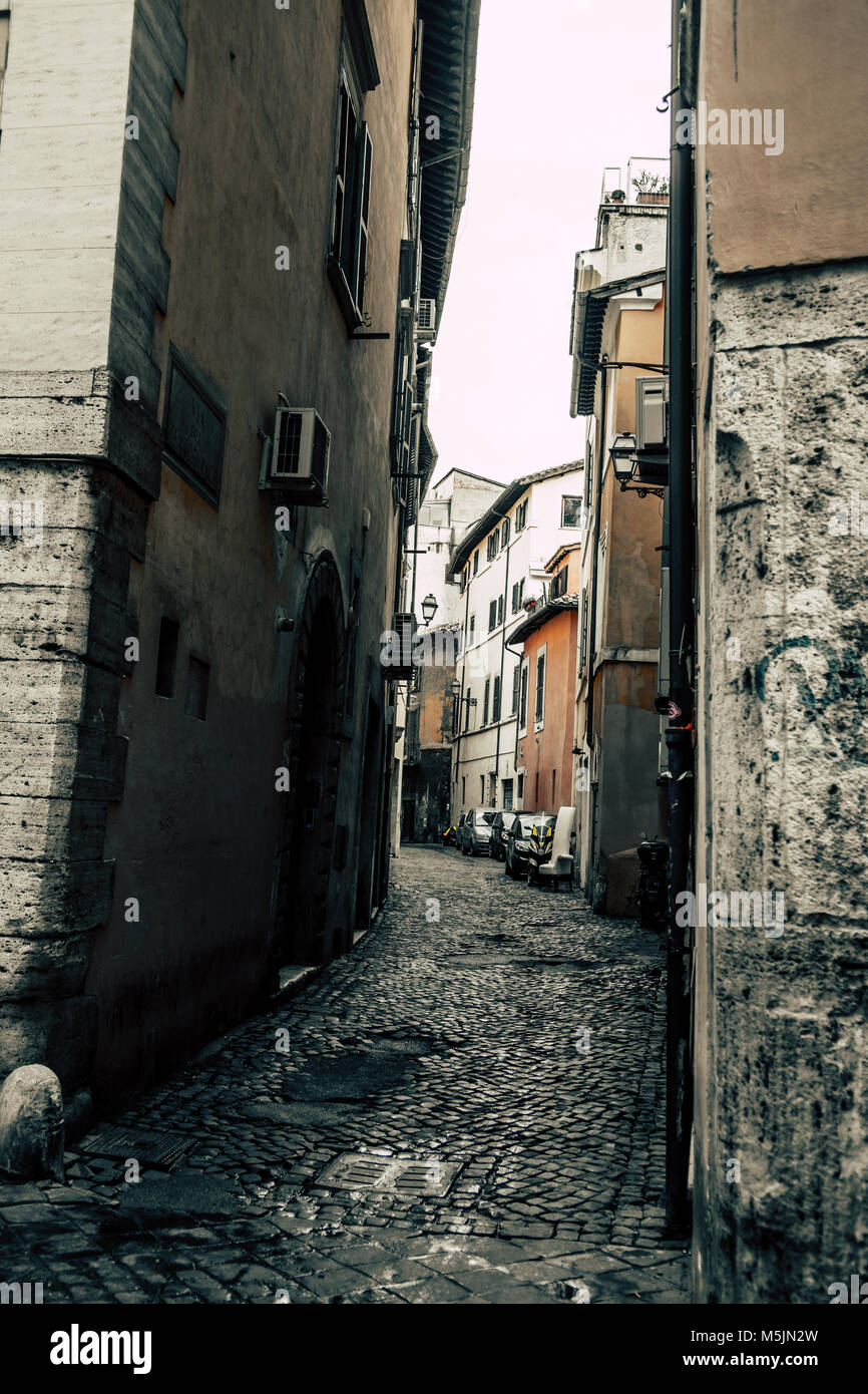 Narrow Mysterious Street in Rome in Italy - Stock Image