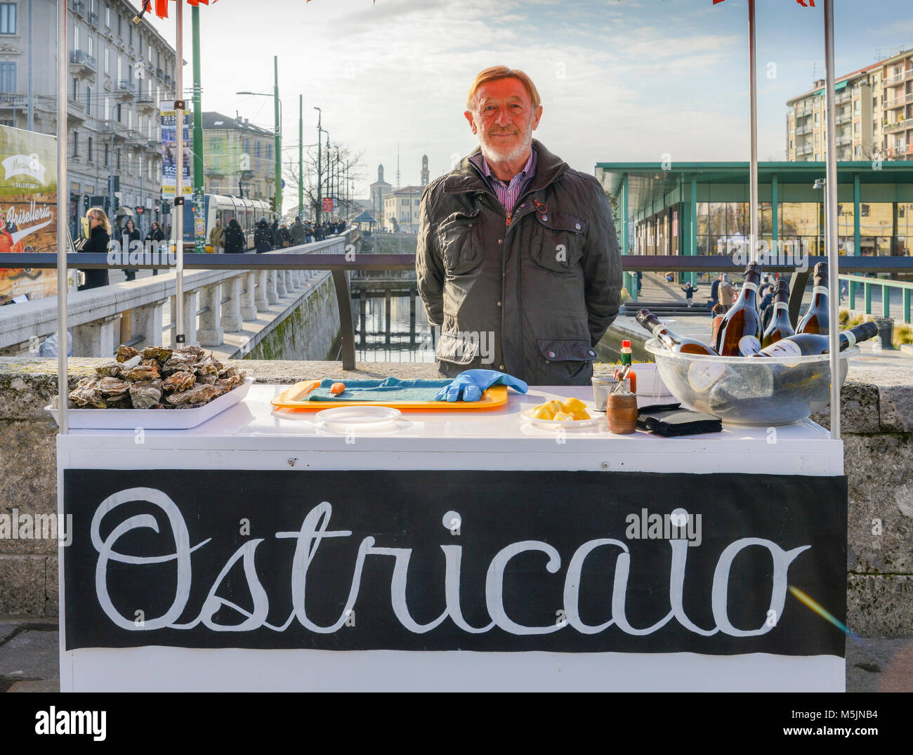Milan, Italy - Feb 24, 2018: Fresh oysters for sale in Darsena district of Milan, Italy. Ostriciao is Italian for - Stock Image