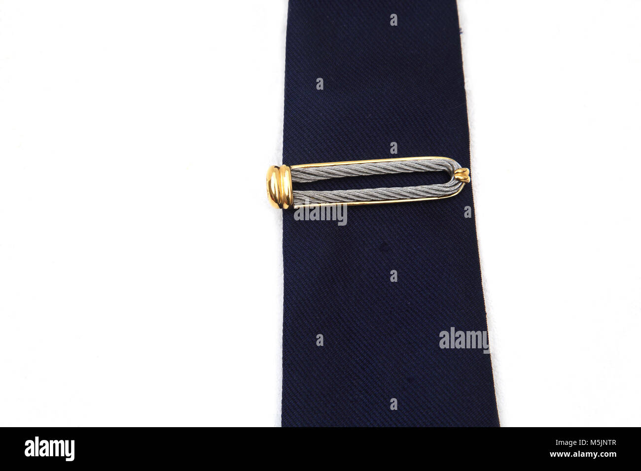 Stainless Steel, Silver And Gold Plated Charriol Tie Pin On Blue Tie Stock Photo