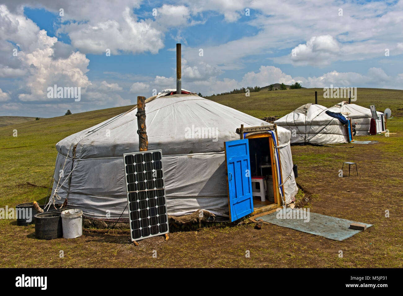 Yurts with solar cell and satellite dish in the steppe,near Erdenet,Mongolia - Stock Image