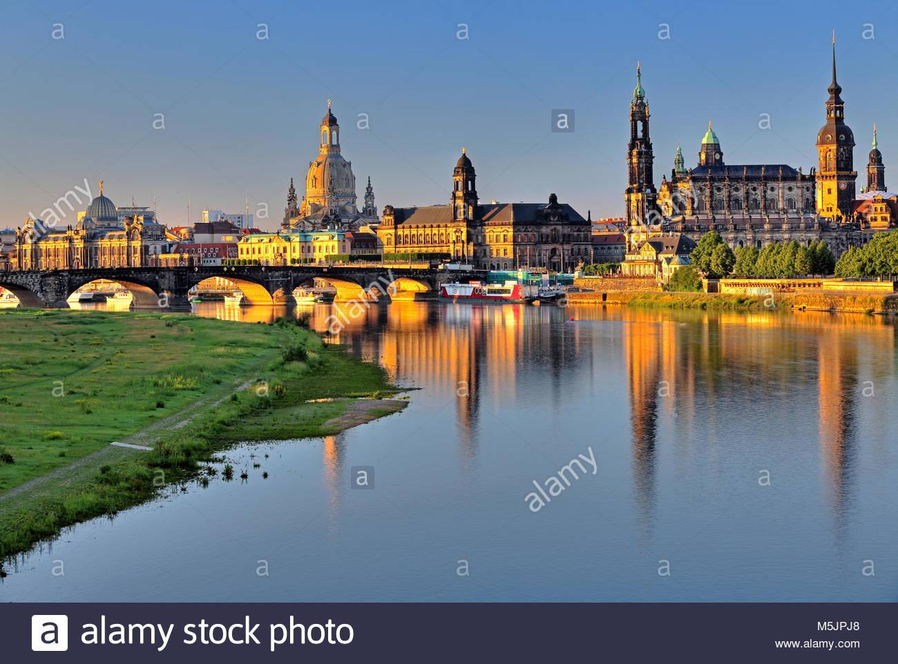 Elbe river with Augustusbrücke,University of Art,Frauenkirche,Higher Regional Court,Hofkirche and Schlossturm,Old - Stock Image