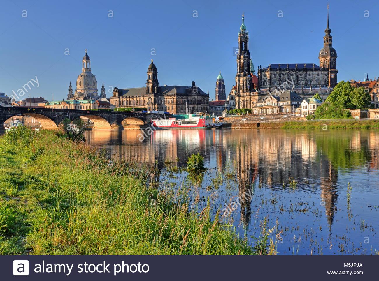 Elbe river with Augustusbrücke,Frauenkirche,Higher Regional Court,Hofkirche and Schlossturm,Old Town,Dresden,Saxony - Stock Image