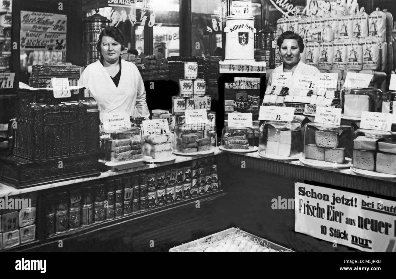 grocery store two saleswomen in the tante emma laden 1920s germany stock photo 175589999 alamy. Black Bedroom Furniture Sets. Home Design Ideas
