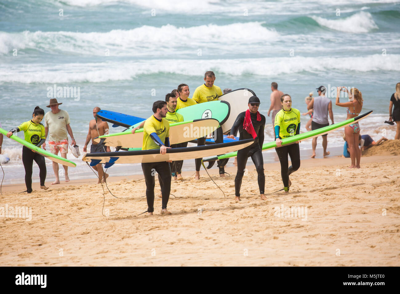 People having a surfing lesson on Manly beach with Manly surf school,Sydney,Australia - Stock Image