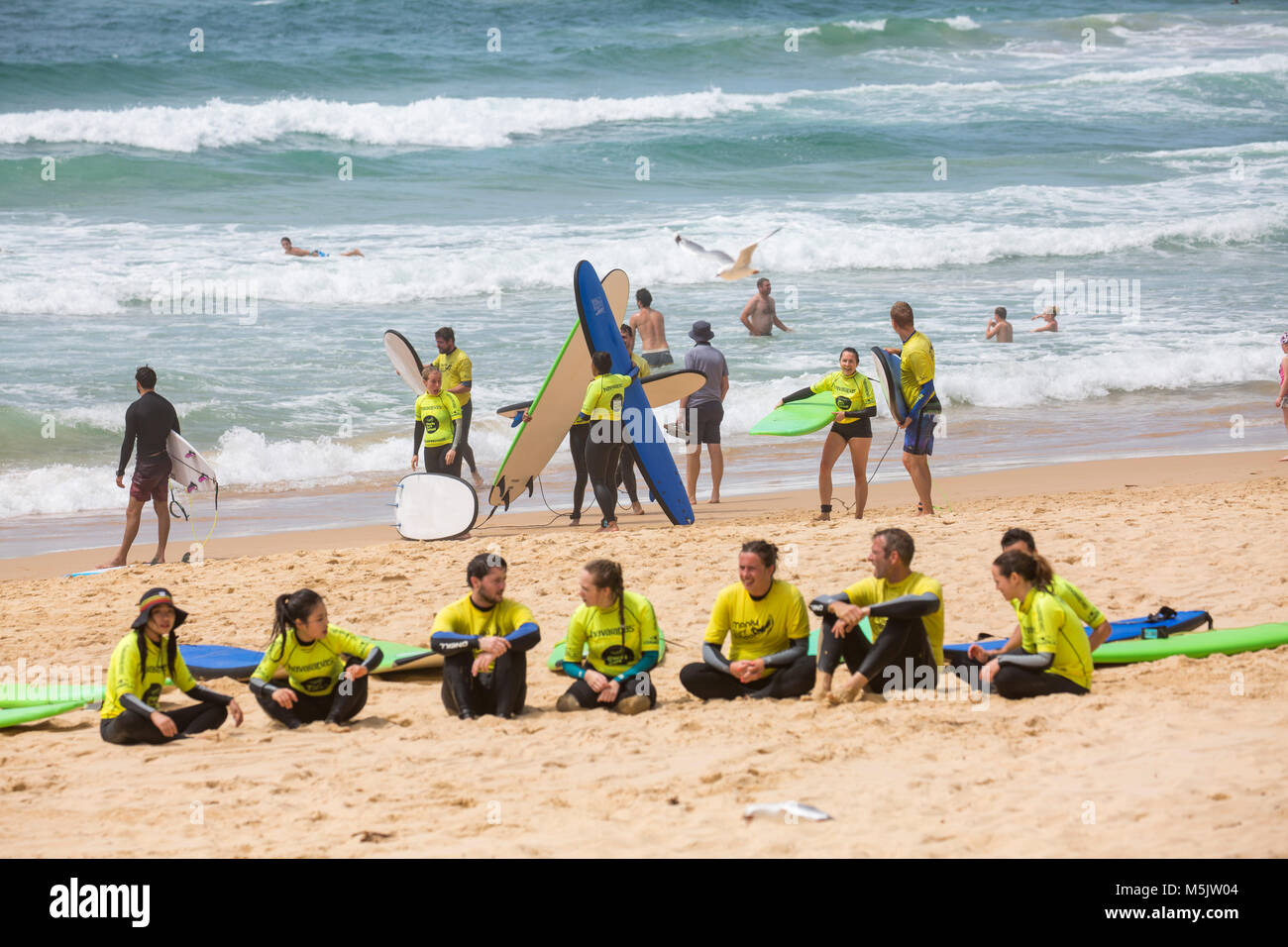 People having a surf lesson with Manly surf school on Manly beach in Sydney,Australia - Stock Image