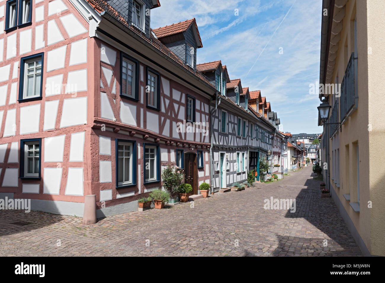 Small alley with half-timbered houses in the old town of Idstein, Hesse, Germany - Stock Image