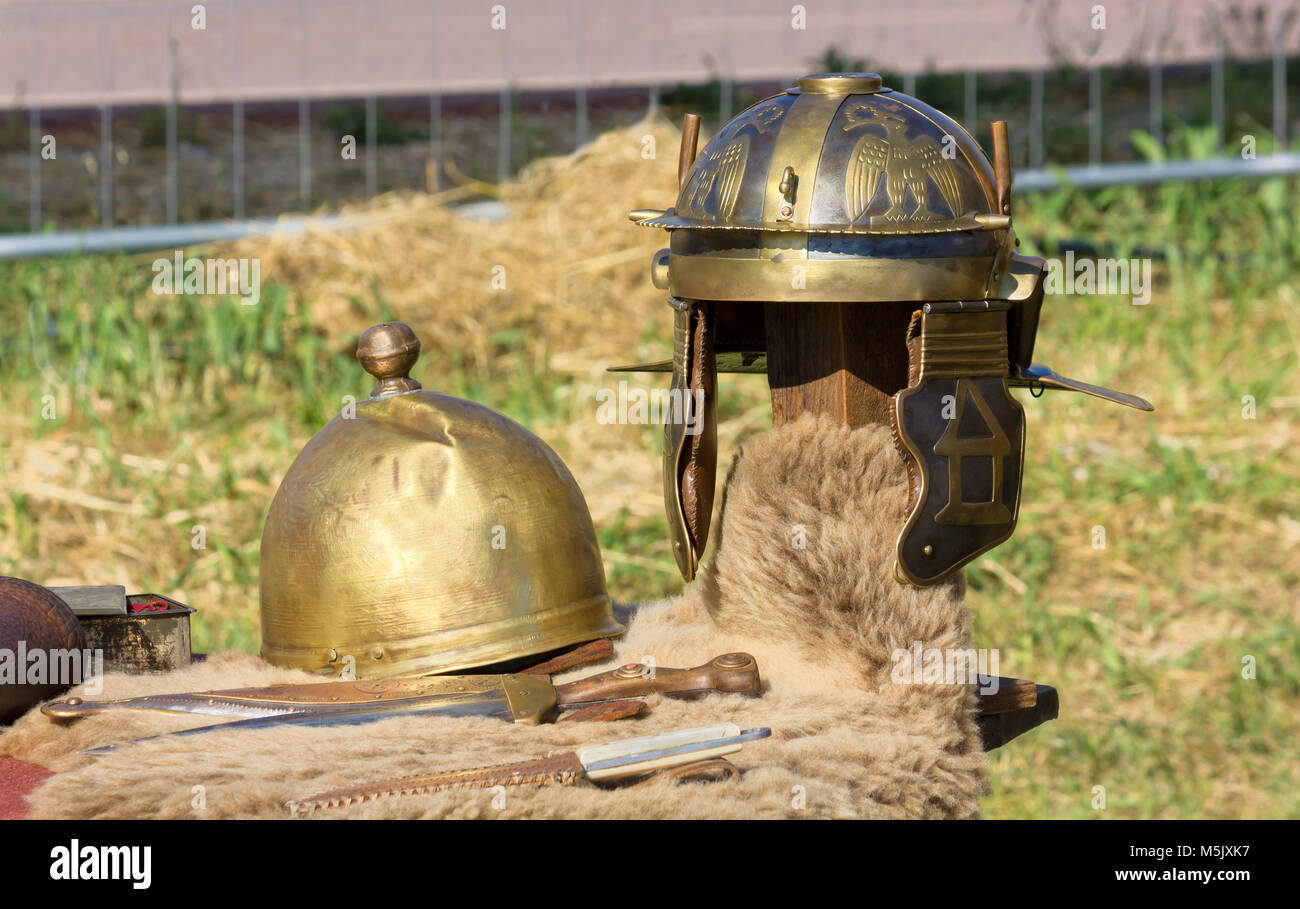 Ancient Roman helmets and daggers at a historical reenactment - Stock Image