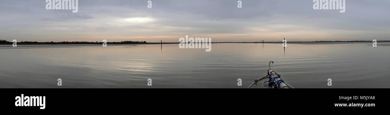 crossing breydon water  great yarmouth norfolk england by boat at slack water in november - Stock Image