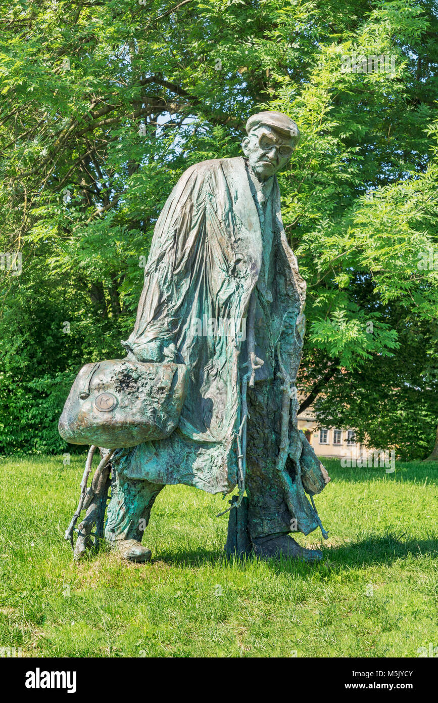 The bronze statue of a tall man with a bag, glasses and cap is located in the Tivoli Park Ljubljana, Slovenia, Europe Stock Photo