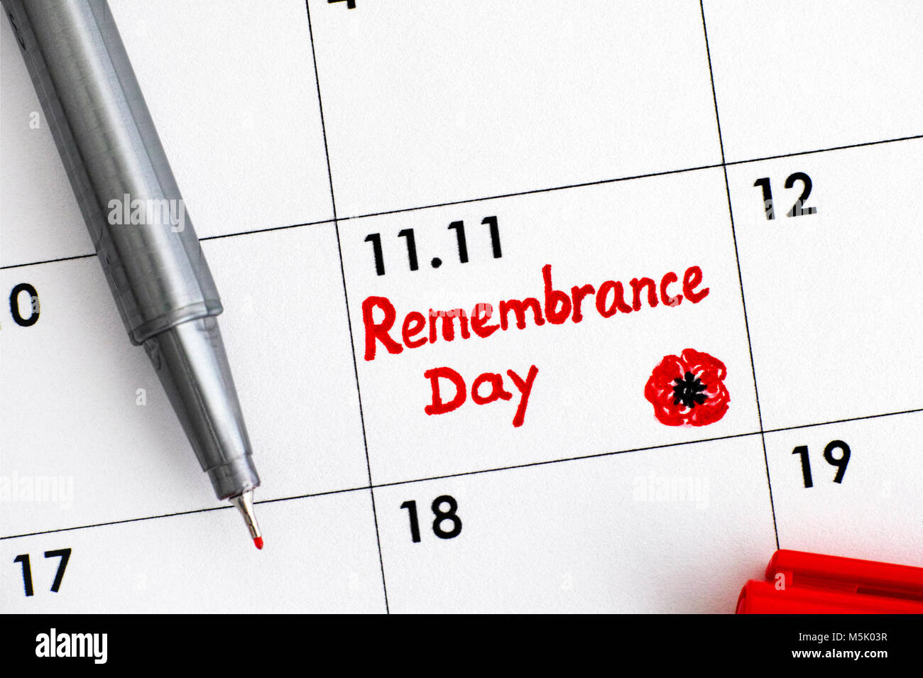 Reminder Remembrance Day in calendar with red pen. Close-up. Stock Photo