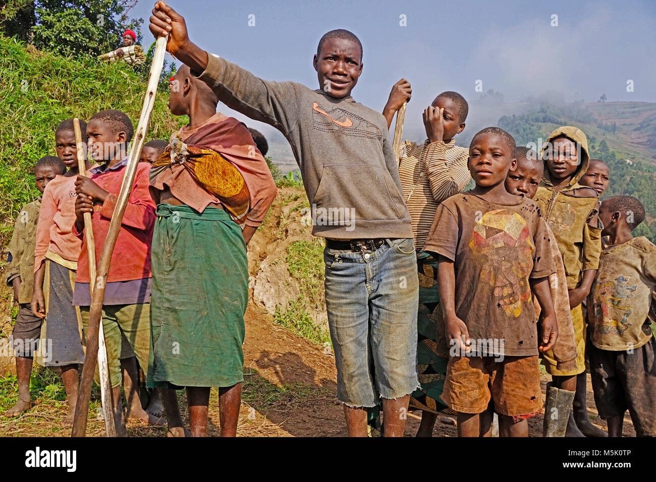 Children from an impoverished village of Batwa Pygmies displaced from their forest habitat and resettled at Lake - Stock Image