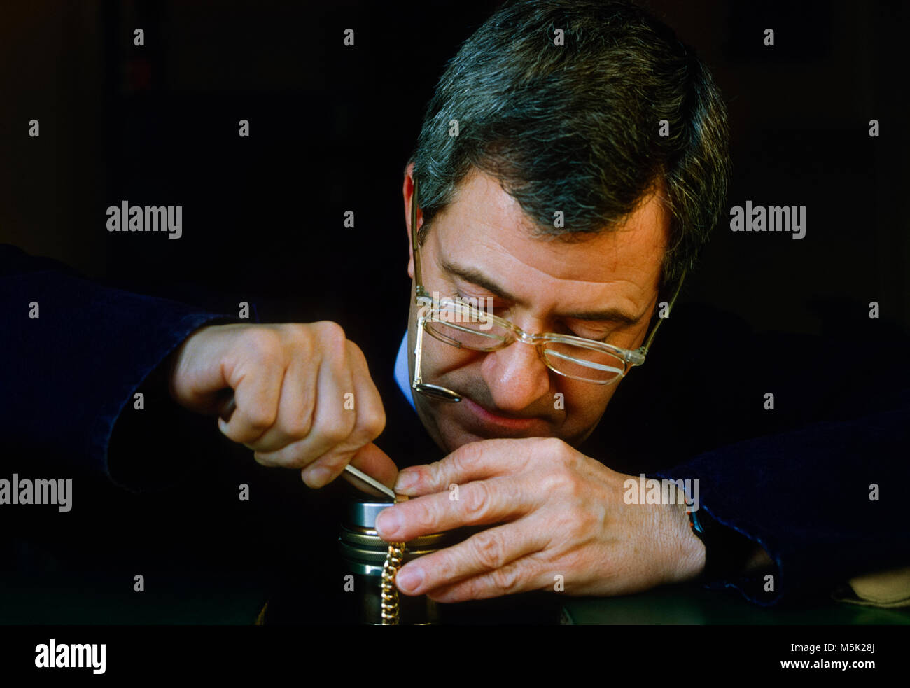 Engraver working on bracelet - Stock Image