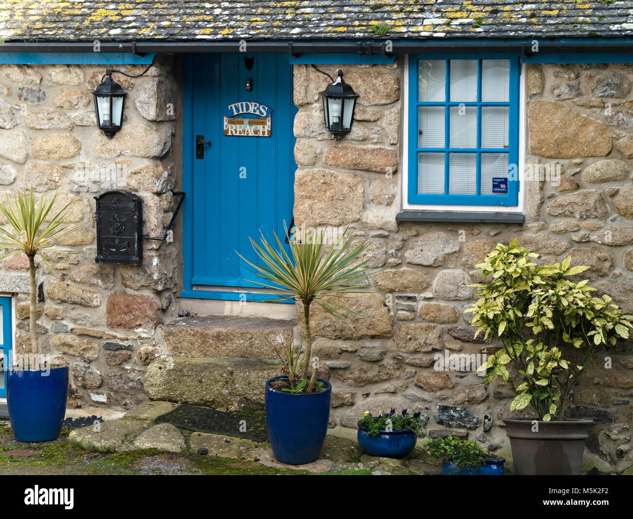 Old pretty granite stone Cornish fishermanu0027s cottage called  Tides Reach  with blue front door Mousehole Cornwall England UK & Old pretty granite stone Cornish fishermanu0027s cottage called