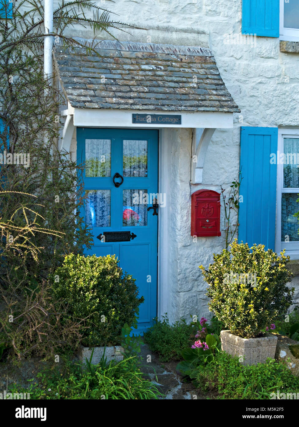 Pretty Whitewashed Cottage With Blue Painted Front Door And Window Stock Photo Alamy