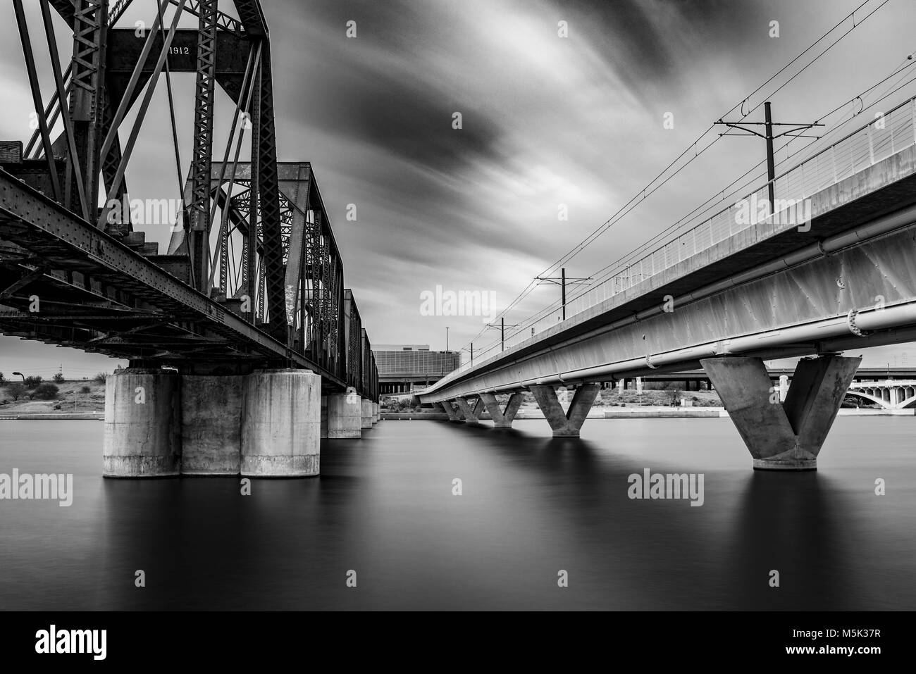 A wonderful moody day in Arizona. It was the perfect cloudy day for some long exposure photography at Tempe Town - Stock Image