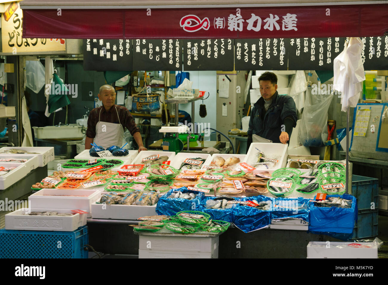 Japanese market with fresh fish and seafood on sale in the