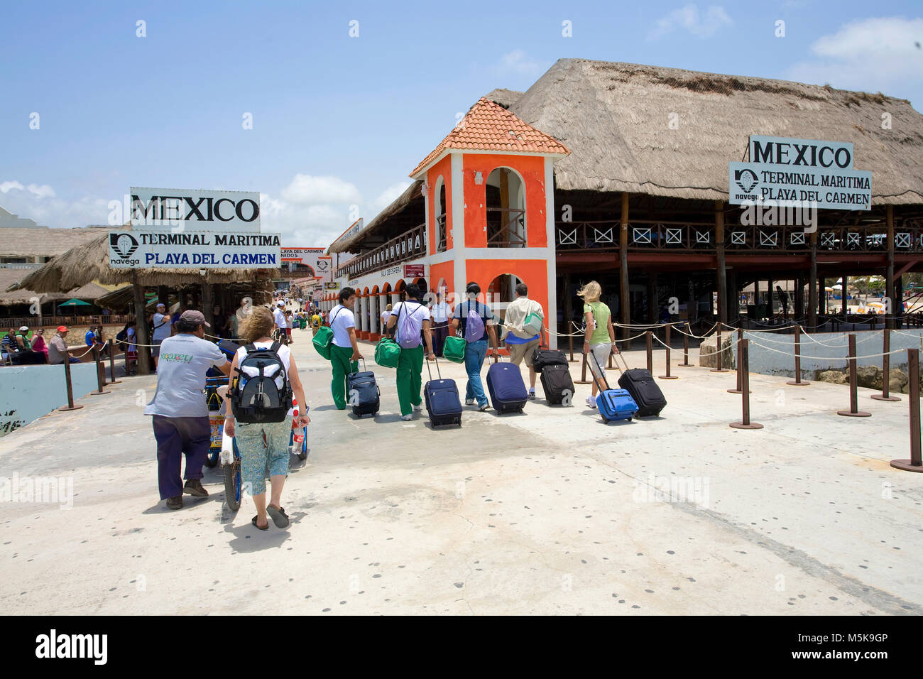 Traveller on pier, departure of ferry from Cozumel to Playa del Carmen, Mexico, Caribbean - Stock Image