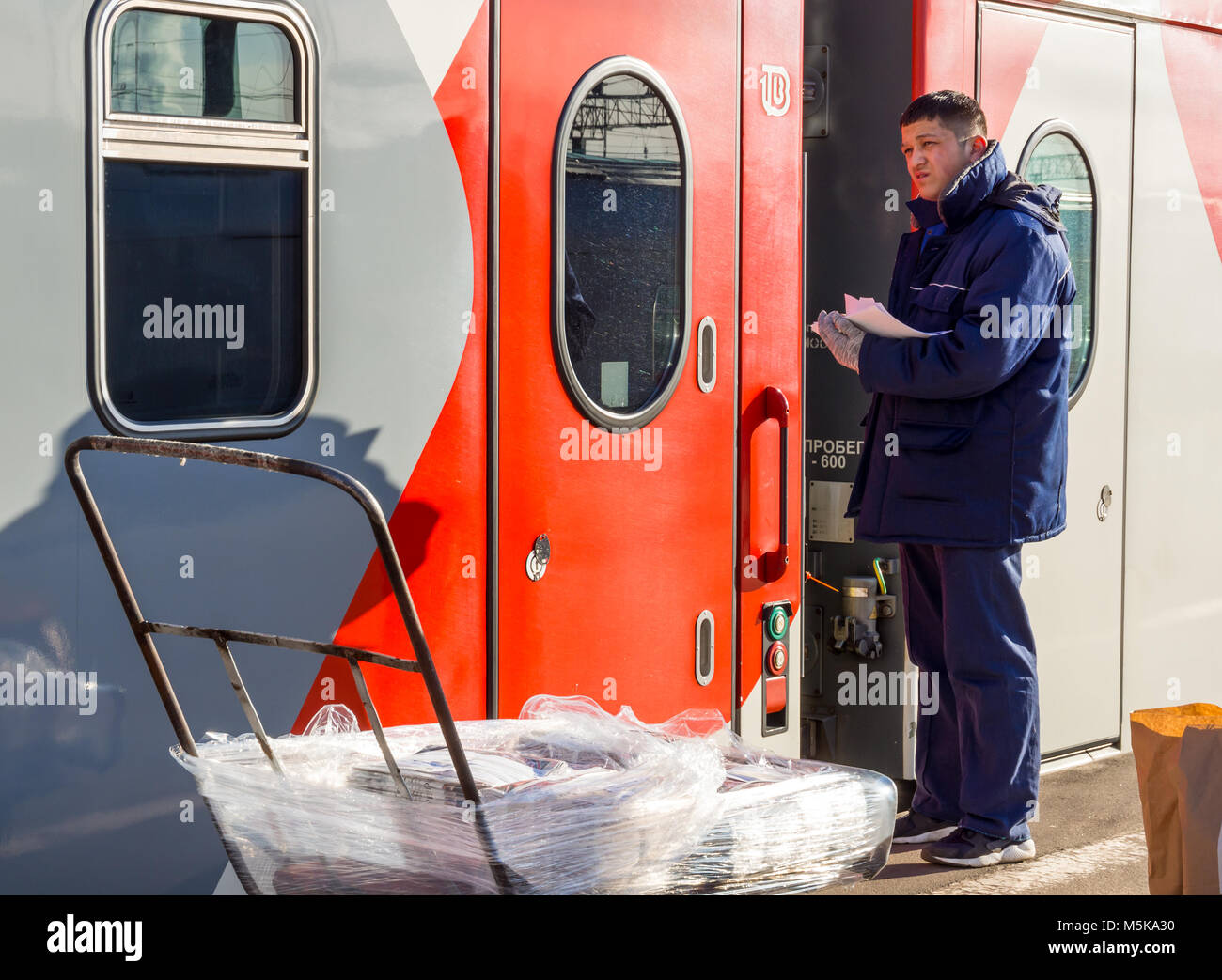 Voronezh, Russia - April 24, 2017: Delivery of the press to the railway car of the train - Stock Image