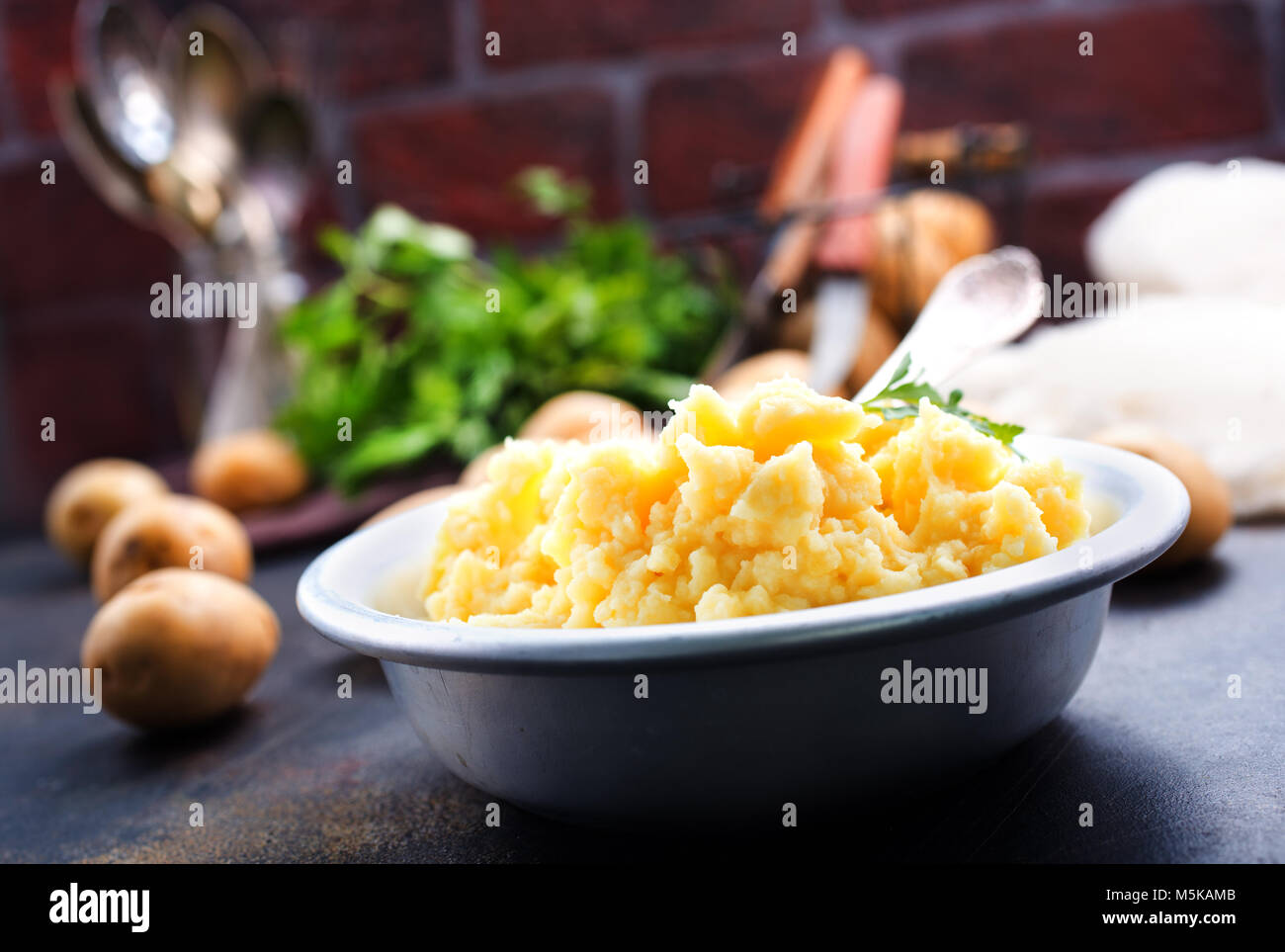 portion of mashed potatoes with butter on a plate - Stock Image