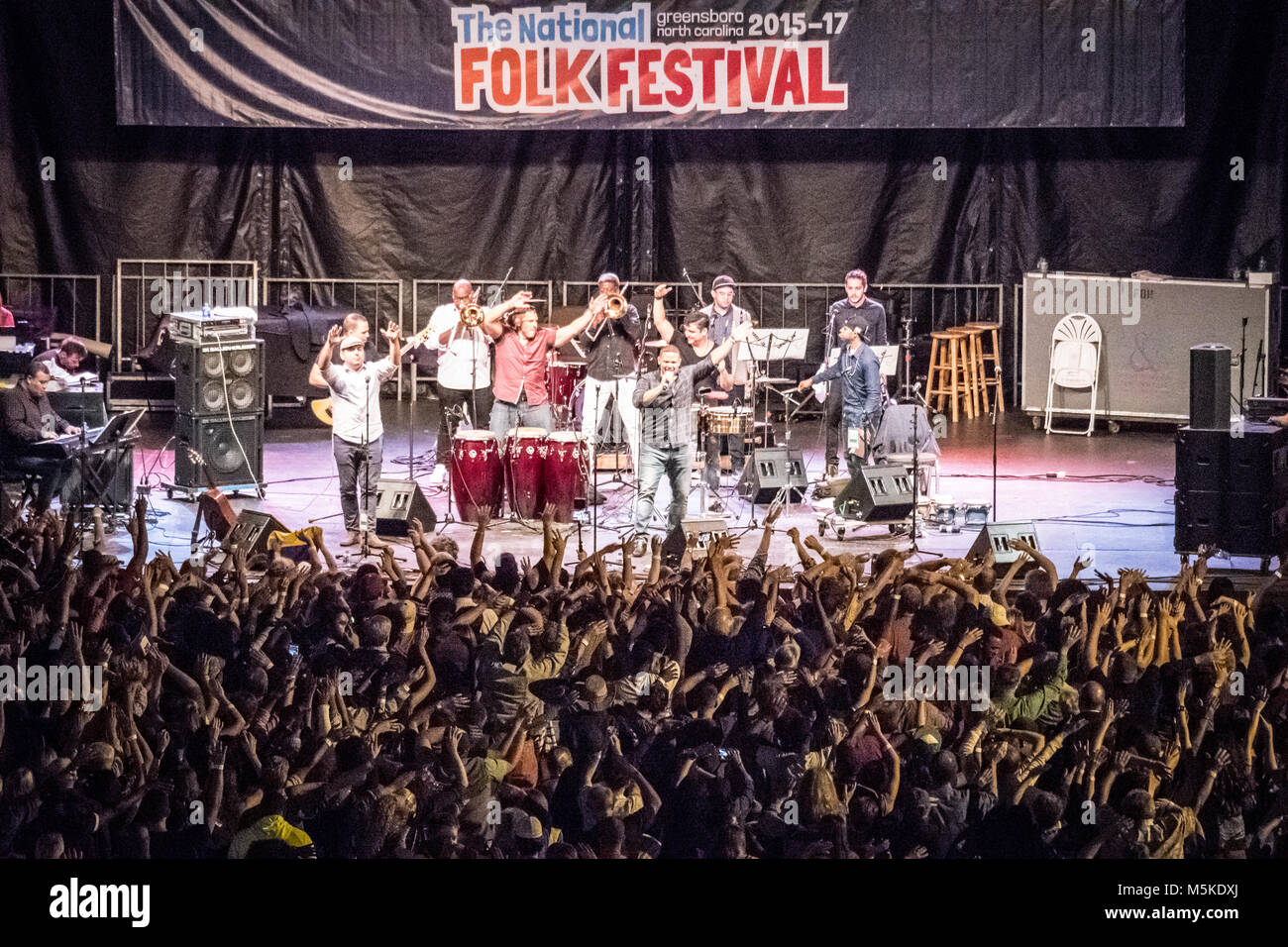 Crowd goes crazy for fast paced performance by Orquesta SCC at National Folk FestivalGreensboro, North Carolina. - Stock Image