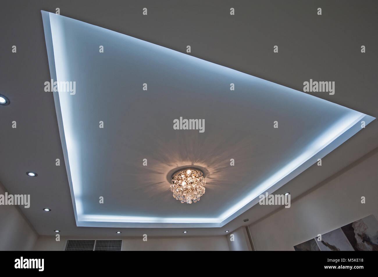 Ornate chandelier style ceiling light inside luxury apartment with ornate chandelier style ceiling light inside luxury apartment with led lighting surround aloadofball Choice Image