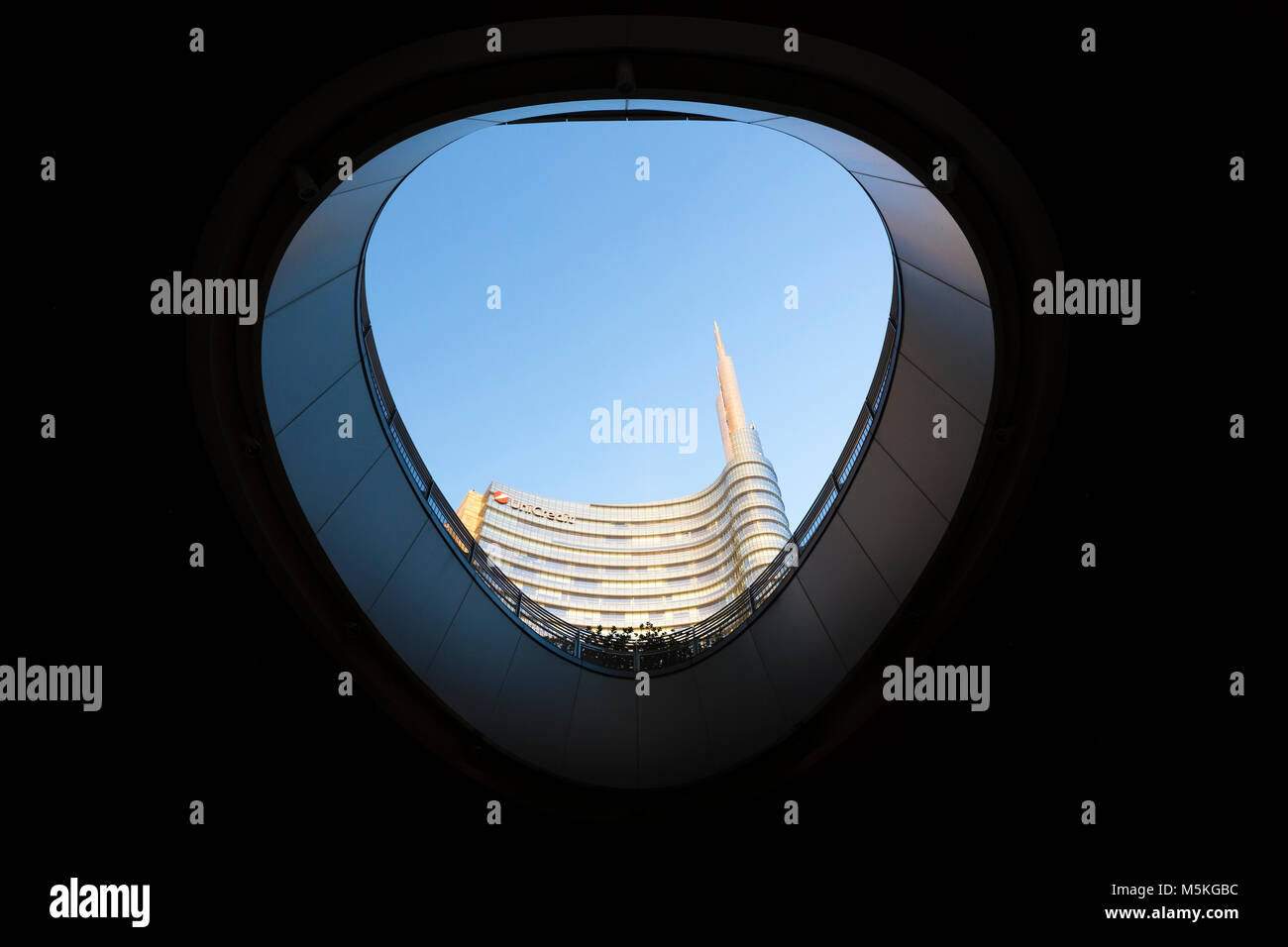 View of the Unicredit Tower spire from the Gae Aulenti square. Milan, Lombardy, Italy. Stock Photo
