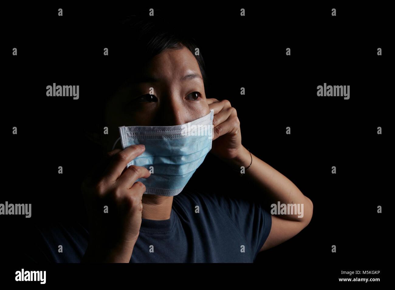 Studio shot to illustrate EPIDEMIOLOGY  Model:  Caroline Cho     Model Release/Consent Forms on File - Stock Image