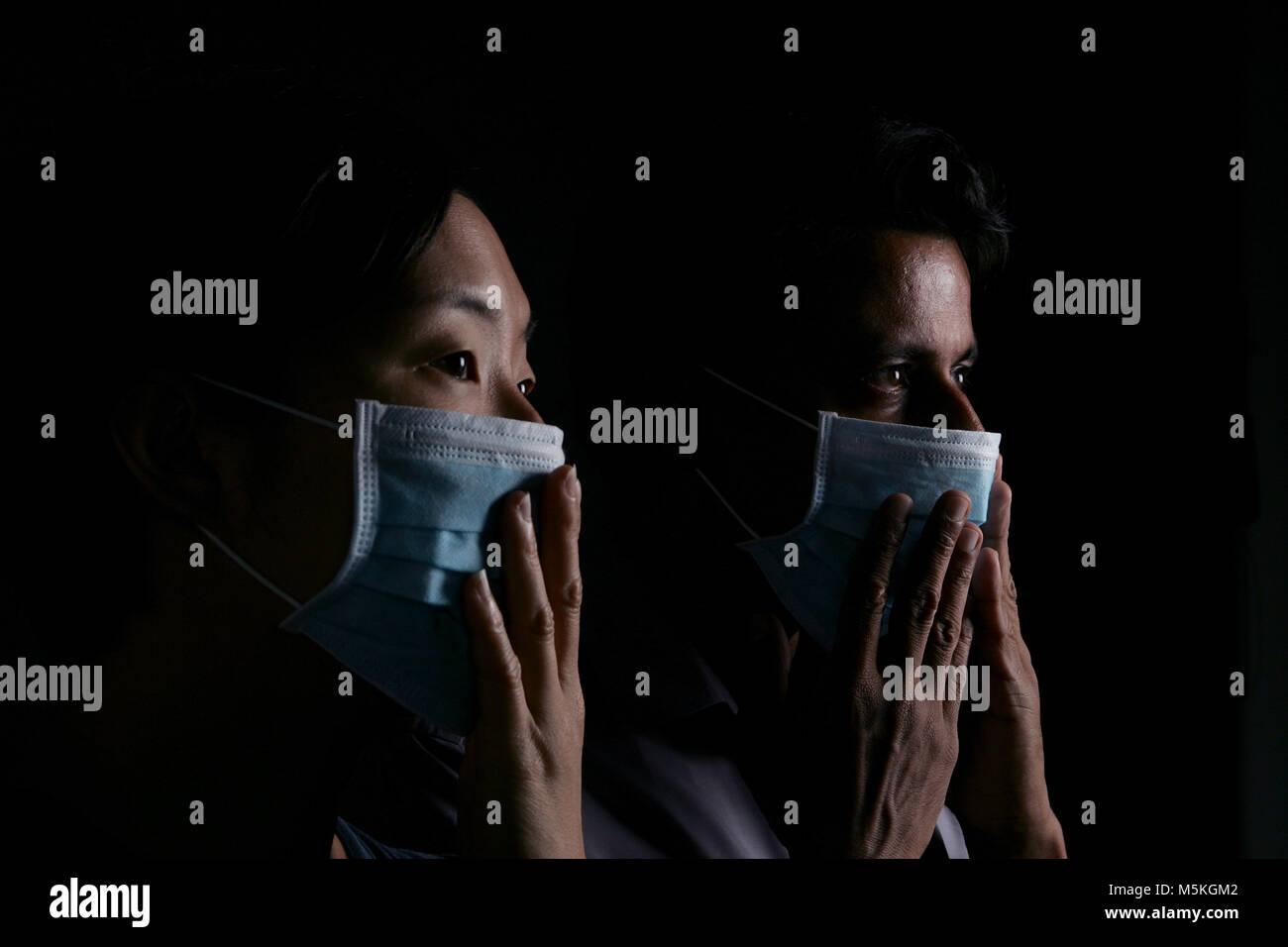 Studio shot to illustrate EPIDEMIOLOGY  Models:   Caroline Cho Satish Vangal    Model Release/Consent Forms on File - Stock Image