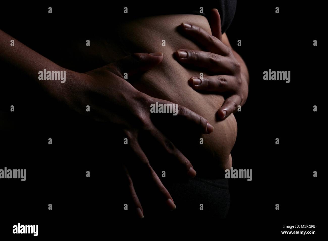 Studio shot to illustrate OBESITY PREVENTION  Model:  Farrah Olieri   Model Release/Consent Form on File - Stock Image