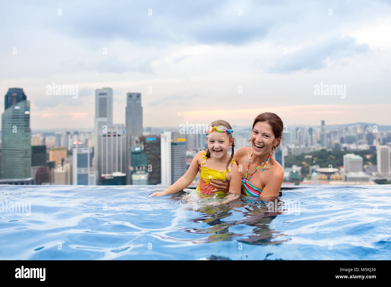Children Swimming In Roof Top Outdoor Pool On Family Vacation In Stock Photo Alamy