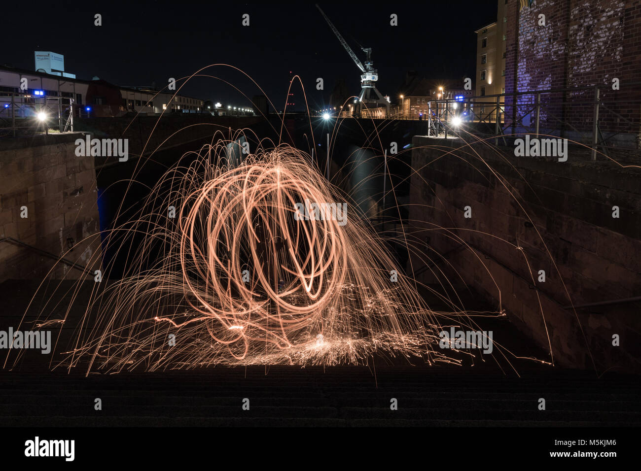 Fireball in the harbour. Steel wool. Stock Photo