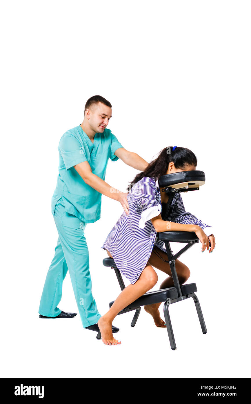 Theme massage and office. Male therapist with blue suit doing back and neck massage for young woman worker, business - Stock Image
