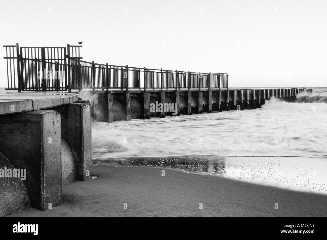 Black and White Photograph of the McGurk Beach Jetty at sunrise in Toes Beach, Playa Del Rey, CA. Stock Photo