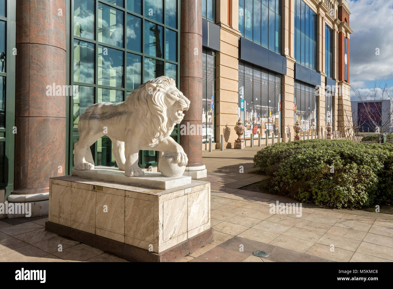 Lion sculpture at the entrance to Barton Square at the intu Trafford Centre, Manchester, UK - Stock Image