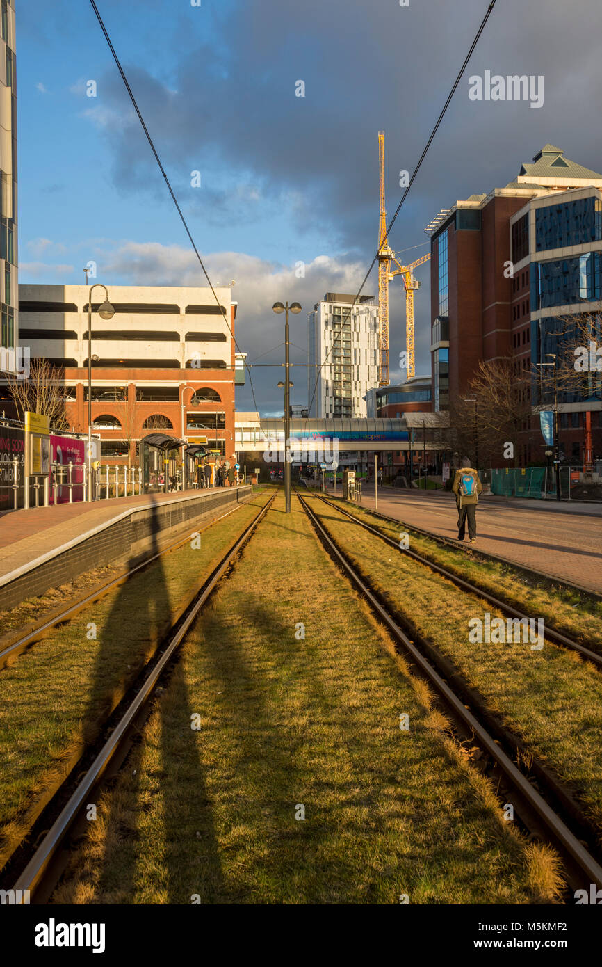 Late afternoon sun on the tracks at the Harbour City Metrolink tram stop, Salford Quays, Manchester, UK - Stock Image